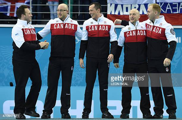 Canada's gold medallists Caleb Flaxey Ryan Harnden EJ Harnden Ryan Fry and Brad Jacobs celebrate on the podium during the Men's Curling Flower...
