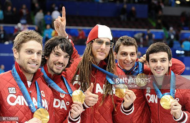 Canada's gold medallists celebrate on the podium during the medal ceremony at the end of the Men's 5000 m relay shorttrack final at the Pacific...
