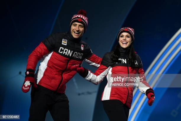 Canada's gold medallists Tessa Virtue and Scott Moir arrive on the podium during the medal ceremony for the figure skating ice dance at the...