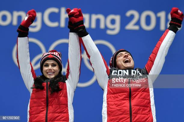 Canada's gold medallists Tessa Virtue and Scott Moir celebrate on the podium during the medal ceremony for the figure skating ice dance at the...