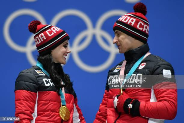 TOPSHOT Canada's gold medallists Tessa Virtue and Scott Moir pose on the podium during the medal ceremony for the figure skating ice dance at the...
