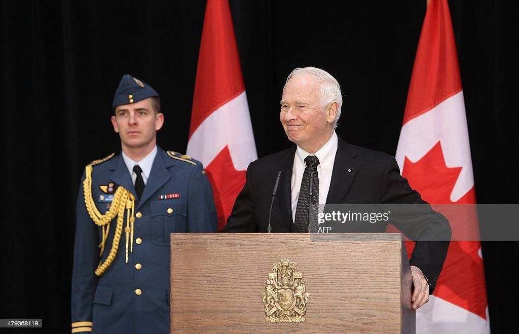 Canada's Governor General David Johnston speaks during the welcoming ceremony for the last of Canada's troops from Afghanistan, as they returned to Ottawa International Airport on March 18, 2014 in Ottawa, Ontario. Eighty-four armed forces members were welcomed home marking the end of Canada's participation in the Afghanistan war, a mission that spanned 12 years. AFP PHOTO/ Cole Burston