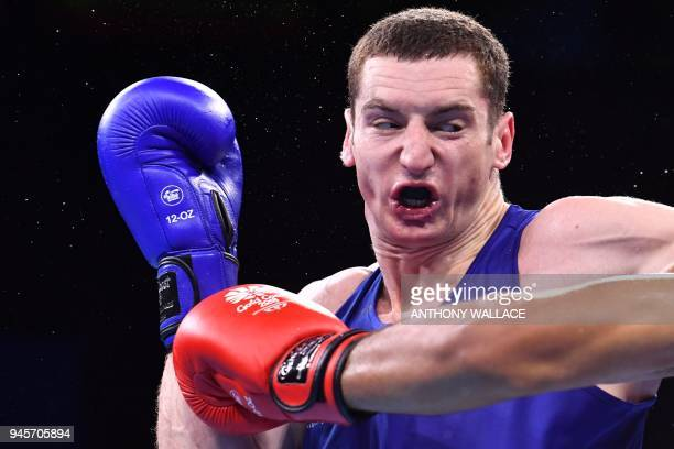 Canada's Harley O'Reilly fights with Samoa's Ato PlodzickiFaoagali during their men's 81kg semifinal boxing match during the 2018 Gold Coast...