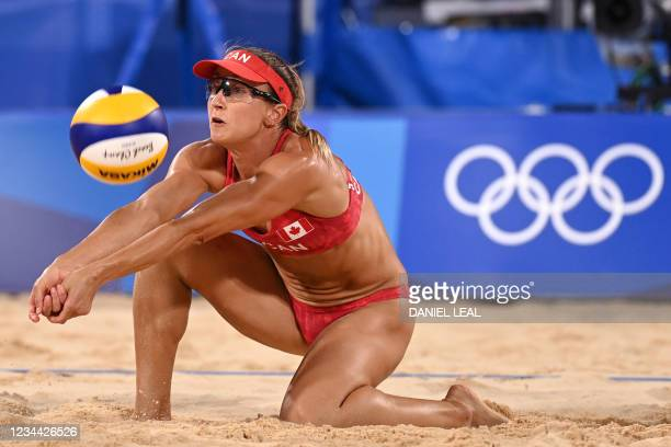 Canada's Heather Bansley digs the ball in their women's beach volleyball quarter-final match between Latvia and Canada during the Tokyo 2020 Olympic...