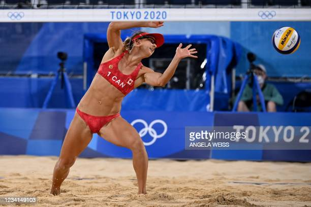 Canada's Heather Bansley reaches for the ball in their women's preliminary beach volleyball pool C match between Canada and China during the Tokyo...