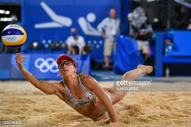Canada's Heather Bansley reaches for the ball in their women's preliminary beach volleyball pool C match between Brazil and Canada during the Tokyo...