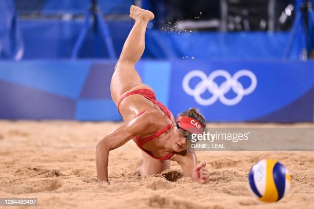 Canada's Heather Bansley reaches for the ball in their women's beach volleyball quarter-final match between Latvia and Canada during the Tokyo 2020...