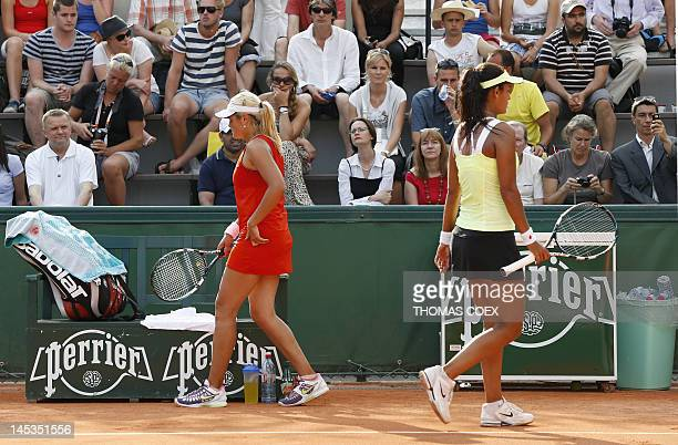 Canada's Heidi El Tabakh passes by Canada's Aleksandra Wozniak during their women's Singles 1st Round tennis match of the French Open tennis...