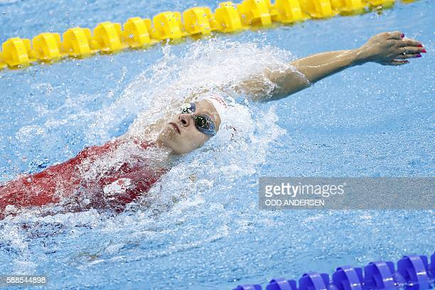 Canada's Hilary Caldwell competes in a Women's 200m Backstroke heat during the swimming event at the Rio 2016 Olympic Games at the Olympic Aquatics...