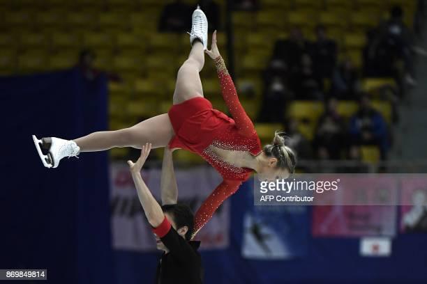 Canada's ice skaters Kirsten MooreTowera and Michael Marinaro perform in Pairs Short Program during the Cup of China ISU Grand Prix of Figure Skating...