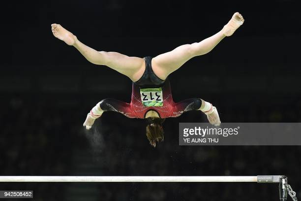 TOPSHOT Canada's Isabela Onyshko competes on the uneven bars during the women's team final and individual qualification in the artistic gymnastics...