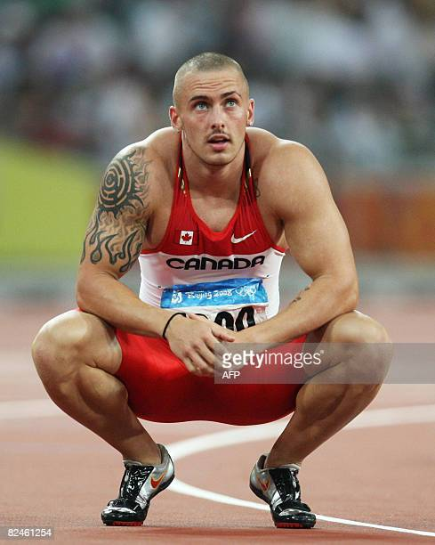 Canada's Jared Connaughton looks at his score after competing in the men's 200m semifinal 1 at the Bird's Nest National Stadium during the 2008...