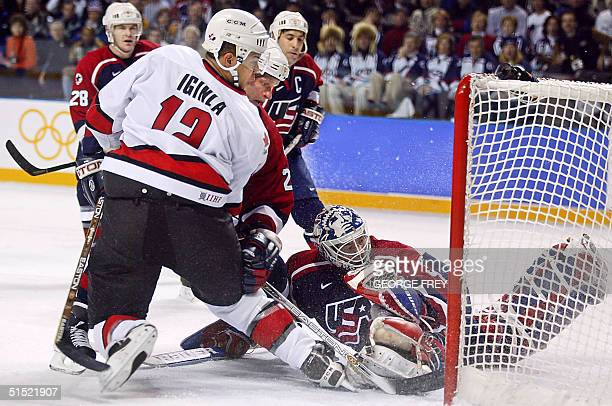 Canada's Jarome Iginla scores Canada's second first period goal before USA goalie Mike Richter during the Men's gold medal Ice Hockey match of the...