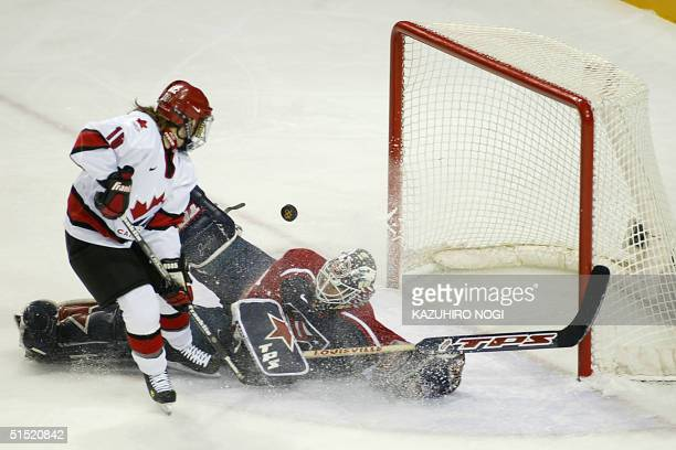 Canada's Jayna Hefford scores over US goalie Sara DeCosta in the second period during their Women's Hockey gold medal final of the XIX Winter...