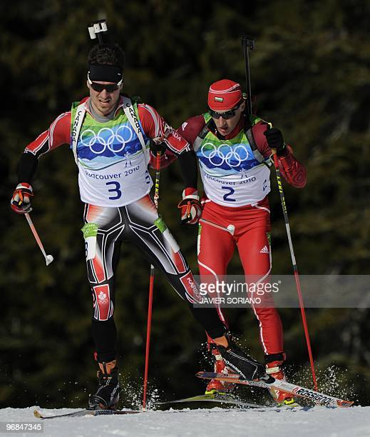 Canada's Jean Phillipe Leguellec and Bulgaria's Krasimir Anev compete during the men's Biathlon 20 km individual at the Whistler Olympic Park during...