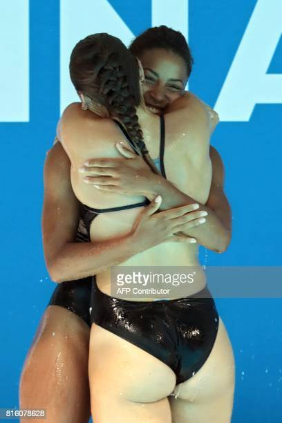 Canada's Jennifer Abel and Canada's Melissa Citrini Beaulieu react after competing in the women's 3m springboard synchro final during the diving...