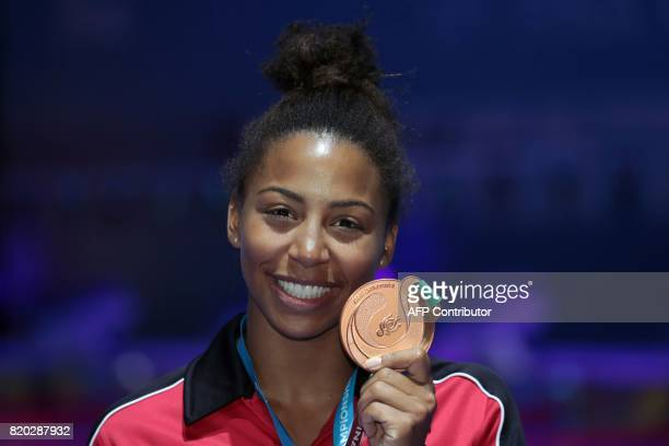 Canada's Jennifer Abel poses with the bronze medal during the podium ceremony for the women's 3m springboard final during the diving competition at...