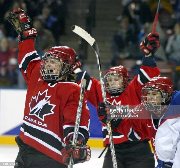 Canada's Jennifer Botterill and teammates celebrate her goal against Russia during their preliminary round Group A Women's Ice Hockey match at the...