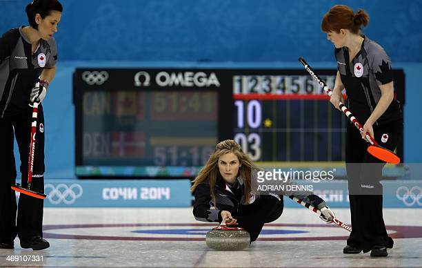 Canada's Jennifer Jones throws her stone during the women's curling round robin session 5 match between Canada and Denmark at the Ice Cube curling...
