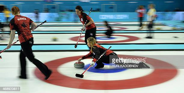 Canada's Jennifer Jones throws the stone during the 2014 Sochi winter Olympics women's curling round robin session 4 match against Great Britain at...