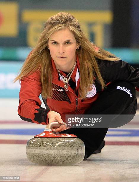 Canada's Jennifer Jones throws the stone during the 2014 Sochi winter Olympics women's curling round robin session 8 match Japan against Canada at...