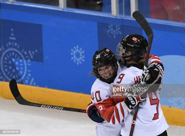 Canada's Jennifer Wakefield and Canada's Blayre Turnbull celebrate a goal in the women's semifinal ice hockey match between Canada and the Olympic...