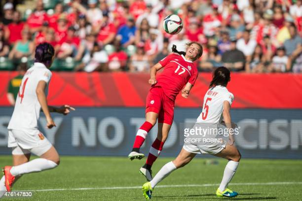 Canada's Jessie Fleming heads the ball above China's Wu Haiyan during the opening match of the FIFA Women World Cup between Canada and China at...