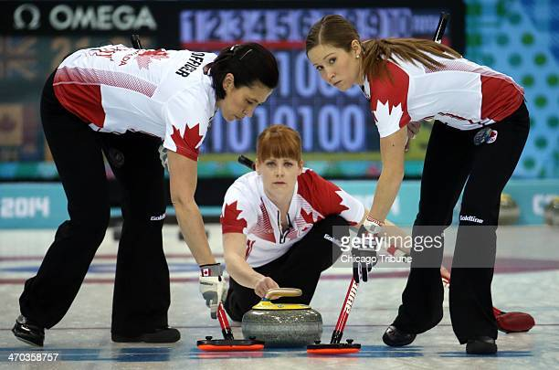 Canada's Jill Officer Dawn McEwen and Kaitlyn Lawes throw during their victory over Great Britain in the women's curling semifinals at the Ice Cube...