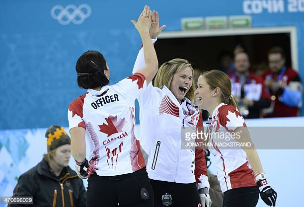 Canada's Jill Officer Jennifer Jones and Kaitlyn Lawes celebrate winning gold in the Women's Curling Gold Medal Game Sweden vs Canada at the Ice Cube...