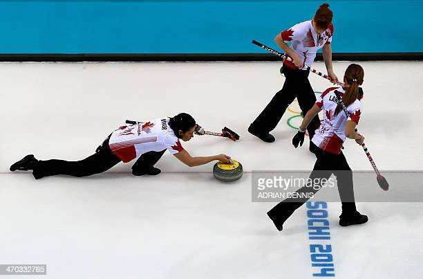 Canada's Jill Officer throws the stone during the women's semifinal match between Great Britain and Canada at the Ice Cube curling centre in Sochi on...