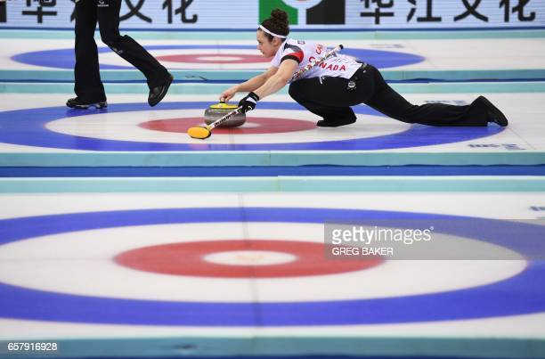 Canada's Joanne Courtney releases the stone during the gold medal match against Russia at the Women's Curling World Championships in Beijing on March...