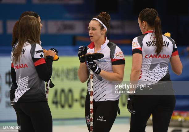 Canada's Joanne Courtney speaks with team mates Emma Miskew Rachel Homan and Lisa Weagle during their match against Russia at the Women's Curling...