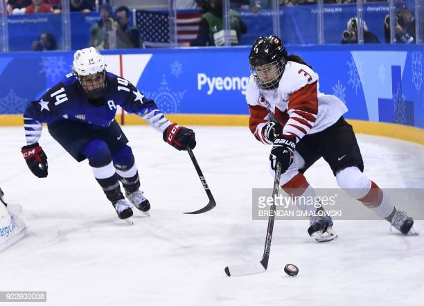 Canada's Jocelyne Larocque and USA's Brianna Decker chase the puck in the women's gold medal ice hockey match between Canada and the US during the...