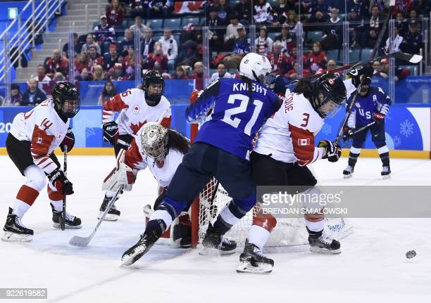Canada's Jocelyne Larocque and USA's Hilary Knight vie for the puck in the women's gold medal ice hockey match between Canada and the US during the...