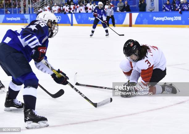 Canada's Jocelyne Larocque falls to the ground in the women's gold medal ice hockey match between Canada and the US during the Pyeongchang 2018...