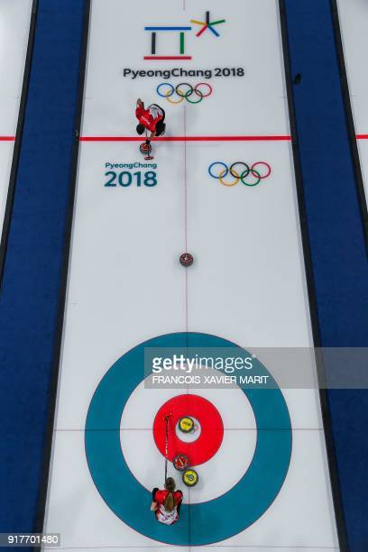 Canada's John Morris and Kaitlyn Lawes compete during the curling mixed doubles gold medal game against Switzerland during the Pyeongchang 2018...