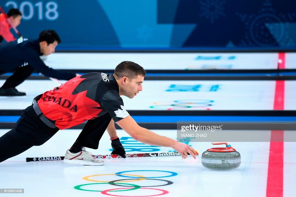 Canada's John Morris throws the stone during the curling mixed doubles round robin session between Canada and Norway during the Pyeongchang 2018 Winter Olympic Games at the Gangneung Curling Centre in Gangneung on February 8, 2018. / AFP PHOTO / WANG Zhao