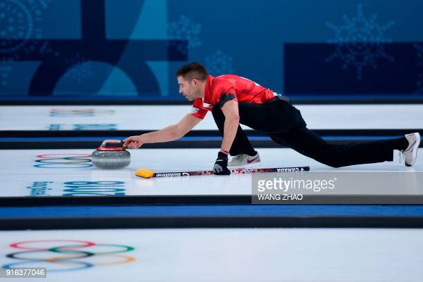 Canada's John Morris throws the stone during the curling mixed doubles round robin session between Canada and Switzerland during the Pyeongchang 2018...