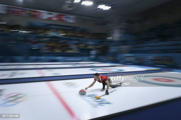 Canada's John Morris throws the stone during the Pyeongchang 2018 Winter Olympic Games at the Gangneung Curling Centre in Gangneung on February 12,...