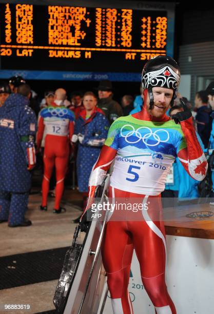 Canada's Jon Montgomery celebrates winning gold in the men's Skeleton final at the Whistler Sliding Centre during the Vancouver Winter Olympics on...
