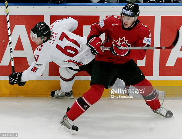 Canada's Jonathan Toews fights for the puck with Switzerland's Romano Lemm during the IIHF World Ice Hockey Championship quarter final match between...