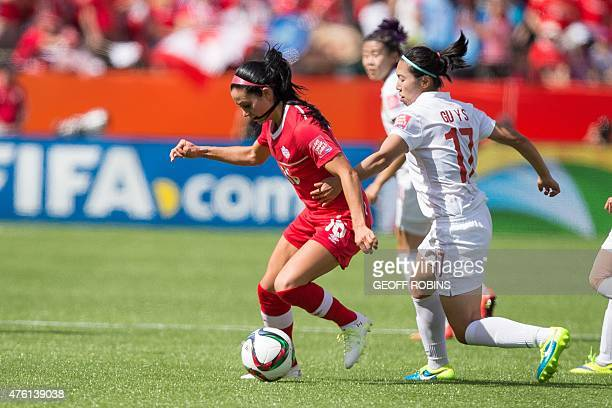 Canada's Jonelle Filigno vies with China's Gu Yasha during a Group A football match between Canada and China at Commonwealth Stadium during the...
