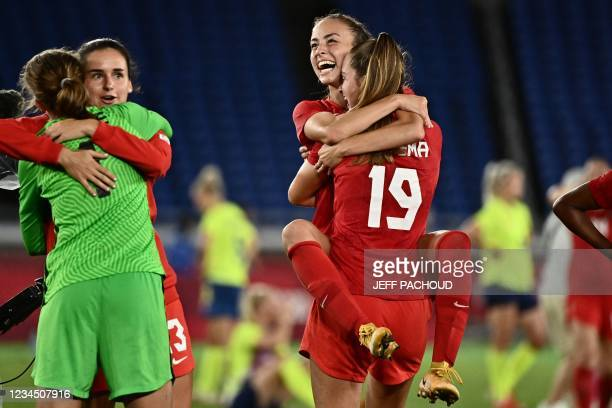 Canada's Julia Grosso hugs Canada's Jordyn Huitema after scoring the winning penalty during the penalty shoot-out of the Tokyo 2020 Olympic Games...