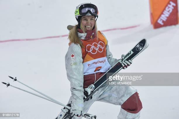 TOPSHOT Canada's Justine DufourLapointe celebrates during the victory ceremony after the women's moguls final event during the Pyeongchang 2018...