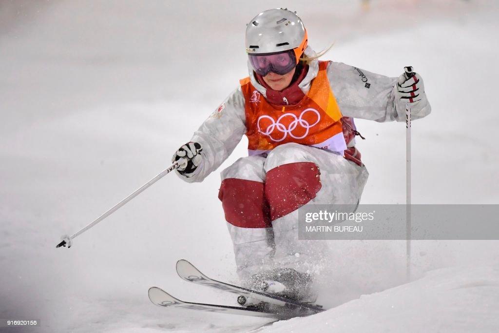 TOPSHOT - Canada's Justine Dufour-Lapointe competes in the women's moguls final 1 during the Pyeongchang 2018 Winter Olympic Games at the Phoenix Park in Pyeongchang on February 11, 2018. / AFP PHOTO / Martin BUREAU
