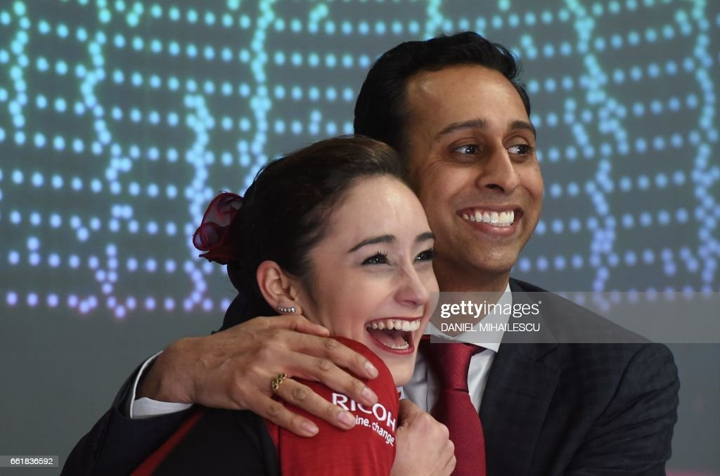 Canada's Kaetlyn Osmond (L) celebrates after the woman's Free Skating event at the ISU World Figure Skating Championships in Helsinki, Finland on March 31, 2017. Evgenia Medvedeva of Russia won the Gold medal ahead of Silver medallist Canada's Kaetlyn Osmond and Bronze medallist Canada's Gabrielle Daleman. / AFP PHOTO / Daniel MIHAILESCU