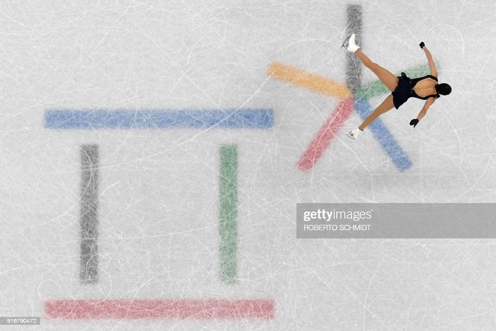TOPSHOT - Canada's Kaetlyn Osmond competes in the figure skating team event women's single skating short program during the Pyeongchang 2018 Winter Olympic Games at the Gangneung Ice Arena in Gangneung on February 11, 2018. / AFP PHOTO / Roberto SCHMIDT