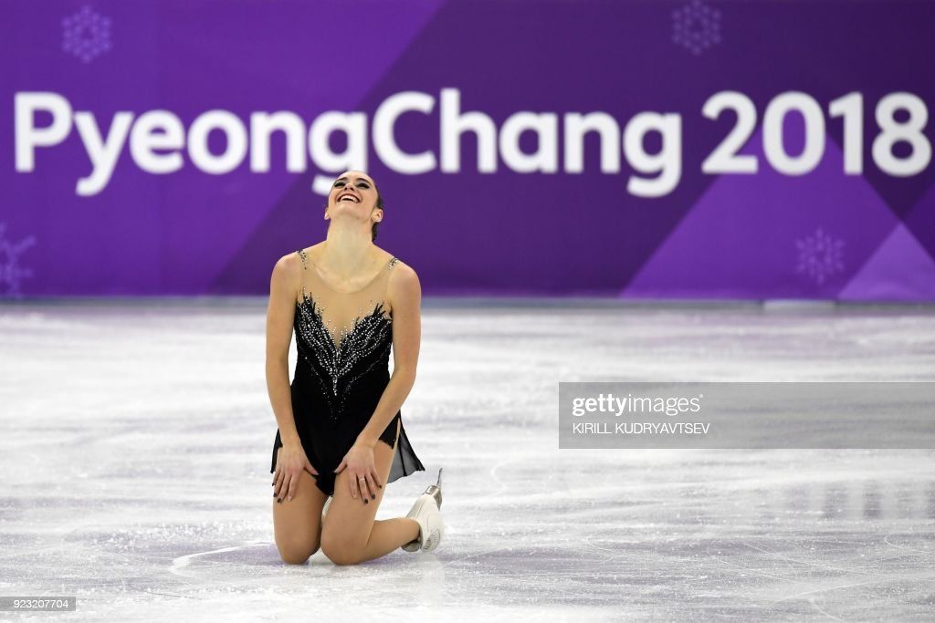 TOPSHOT - Canada's Kaetlyn Osmond competes in the women's single skating free skating of the figure skating event during the Pyeongchang 2018 Winter Olympic Games at the Gangneung Ice Arena in Gangneung on February 23, 2018. / AFP PHOTO / Kirill KUDRYAVTSEV