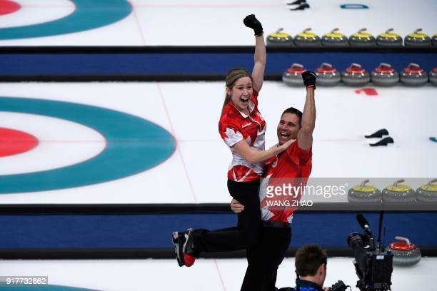 TOPSHOT Canada's Kaitlyn Lawes and Canada's John Morris celebrate winning the curling mixed doubles gold medal game between Canada and Switzerland...