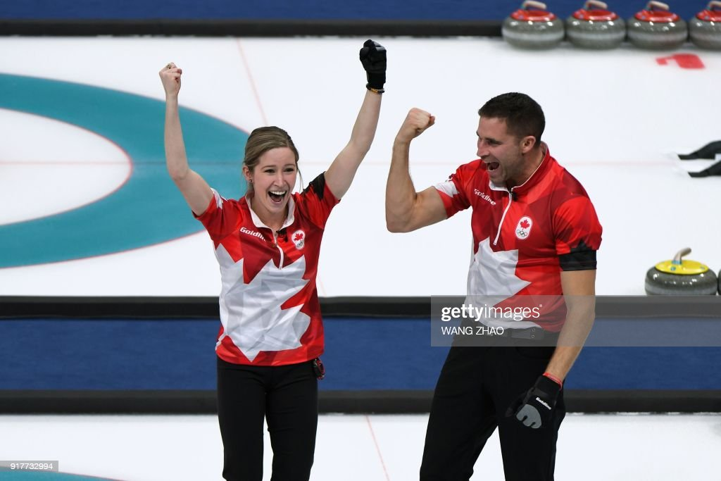 Canada's Kaitlyn Lawes and Canada's John Morris celebrate winning the curling mixed doubles gold medal game between Canada and Switzerland during the Pyeongchang 2018 Winter Olympic Games at the Gangneung Curling Centre in Gangneung on February 13, 2018. / AFP PHOTO / WANG Zhao